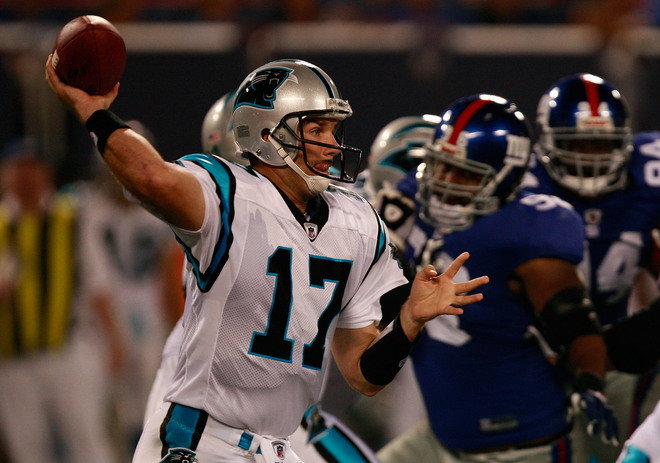 Jake Delhomme attempts a pass against the Giants.